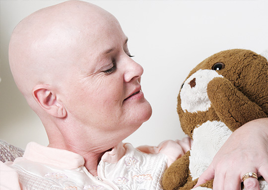 woman recovering from cancer with teddy bear