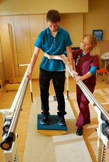 Photo of patient working on balance rehab exercises