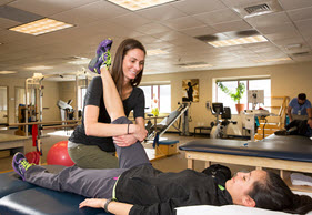 Photo of physical therapist working with a patient