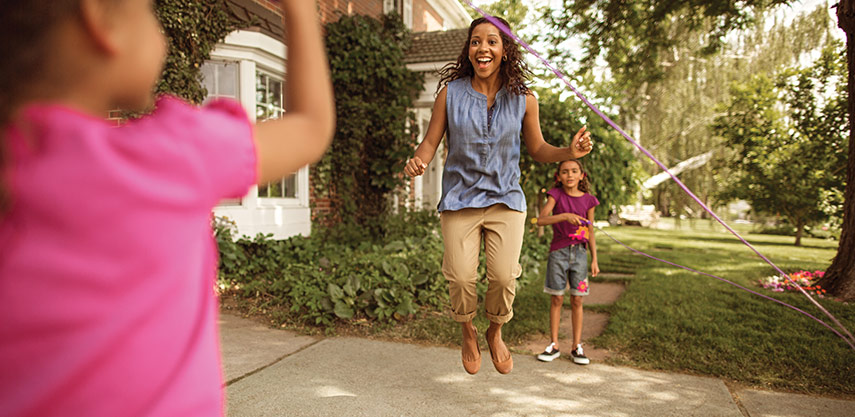 Woman jumping rope with kids
