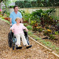 Healing Garden image of lady in wheel chair in the garden