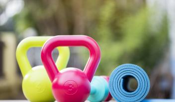 kettlebells and yoga mat